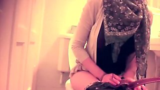 Modern looking woman on the toilet