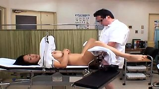 Pretty Japanese babe has a horny doctor plowing her snatch