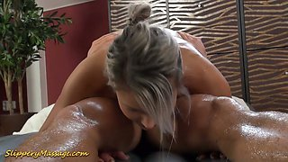 Oiled up masseuse Holly provides her client with an unforgettable massage