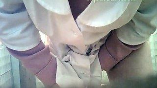 White lady in black nylon pantyhose pisses in the toilet