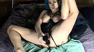 Stacked camgirl in lingerie stretches her ass with a big toy