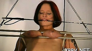Naked babe gets milk sacks roughly stimulated in kinky bdsm