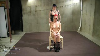 Nasty redhead lesbian slave loves getting her pussy abused hard