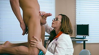 A sexy doctor with glasses is examining a large cock in hospital