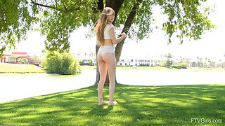 Naughty teen Audrey loves playing in outdoors and flashing her puss