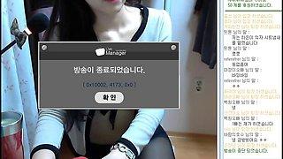 shaven Korean chick strips on webcam