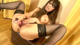 Horny brunette masturbates with a dildo in solio clip