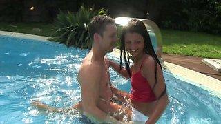 Tanned babe is seduced and rammed right by the pool