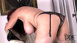 Big boobed sex bomb Joanna Bliss strips for you