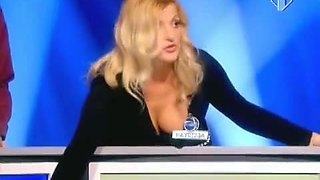 Blonde woman with big juggs gives the audience an eyeful of her melons and ass