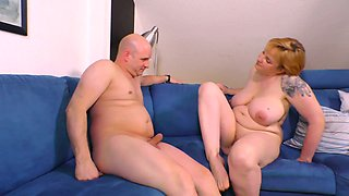 Voluptuous red haired bitch Claudia is so into riding dick and giving titjob