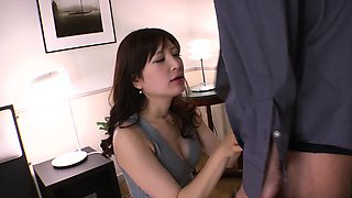 Alluring Japanese chick  swallows a hard hairy rod