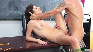 Naughty college gal in short skirt is fucked quite hard on the table