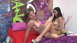 Watch two girls licking and kissing one another in this hot video