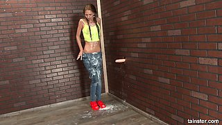Skinny chick is covered with sperm in the glory hole room