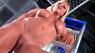 Old muscle woman rubs her big clit