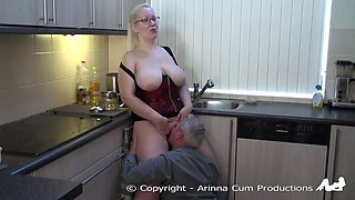 Older couple has some fun on the kitchen counter