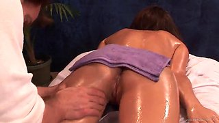 oiled up babe gets nailed during massage